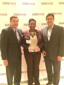DBED's Regina Tillery, Director of Information & Technology Management, accepts the StateScoop award on behalf of the State of Maryland.